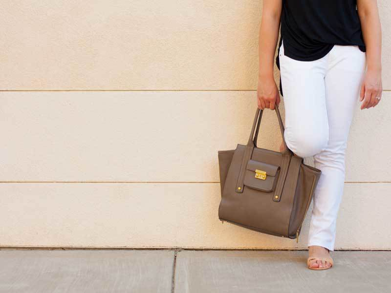 Black hi-low blouse | white denim jeans | gold accented sandals | tan tote | www.shoppingmycloset.com         @lovelibertysage #lovelibertysage @jcrew #jcrew @expresslife #express @31philliplim #philliplim
