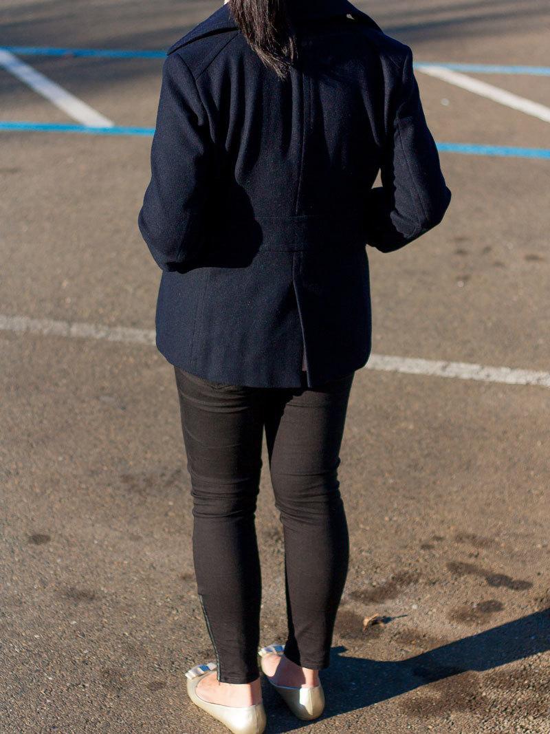 Navy peacoat |beige sleeveless oversized turtleneck sweater | beige silk blouse |  black ankle zipper jeans | gold bow ballet flats | tassel necklace | www.shoppingmycloset.com      @jcrew #jcrew @target #target @vincesays #vince @loft #loft @bananarepublic #bananarepublic @expresslife #express