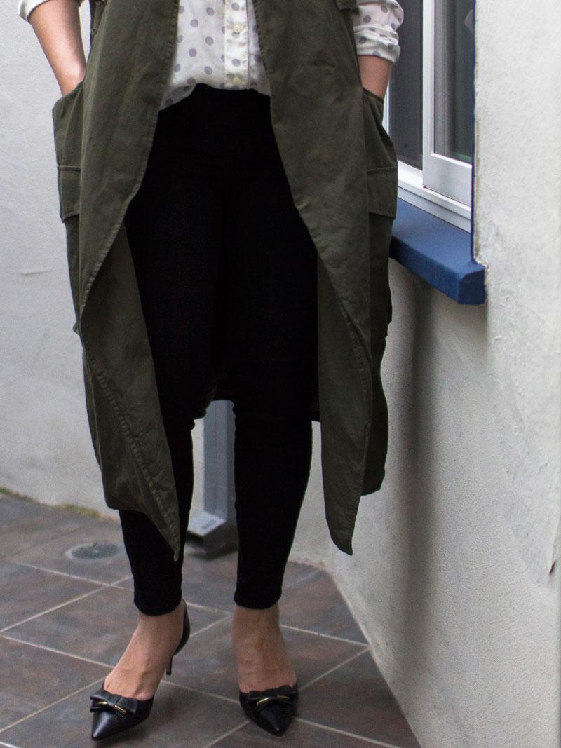 Green sleeveless vest | polka dot top | black ankle pants | black kitten heels     @whowhatwear #whowhatwear @target #target @jcrew #jcrew @loft #loft @ferragamo #ferragamo