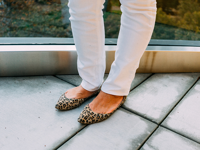 Asymmetrical navy sweater with gold buttons   white jeans   leopard flats   see the entire look at www.shoppingmycloset.com    @ragandbone #ragandbone @jcrew #jcrew @nordstrom #nordstrom