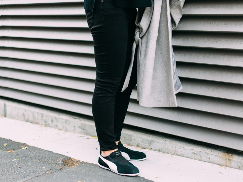 Grey sleeveless coat | black side slit sweater | black skinny jeans | black sneakers | www.shoppingmycloset.com  @asos #asos @jcrew #jcrew @puma-sneakers #puma @alexander-mcqueen #alexandermcqueen