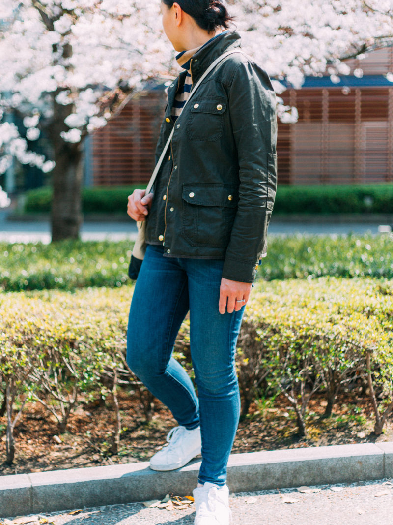 Olive green field jacket | stripe mock neck shirt | skinny ankle crop jeans | white sneakers | colorblock crossbody purse | www.shoppingmycloset.com .   @jcrew #jcrew @currentelliott #currentelliott @adidas #adidas
