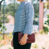 Striped black and white funnelneck shirt (buy here: http://fave.co/2gWANsg) -- Black skinny jeans (buy here: http://fave.co/2gXtAZ8) -- Red quilted purse (buy similar here: http://fave.co/2gWX1dT) -- Grey lace heels (buy here: http://fave.co/2gY9Owt) -- See all the details at www.shoppingmycloset.com
