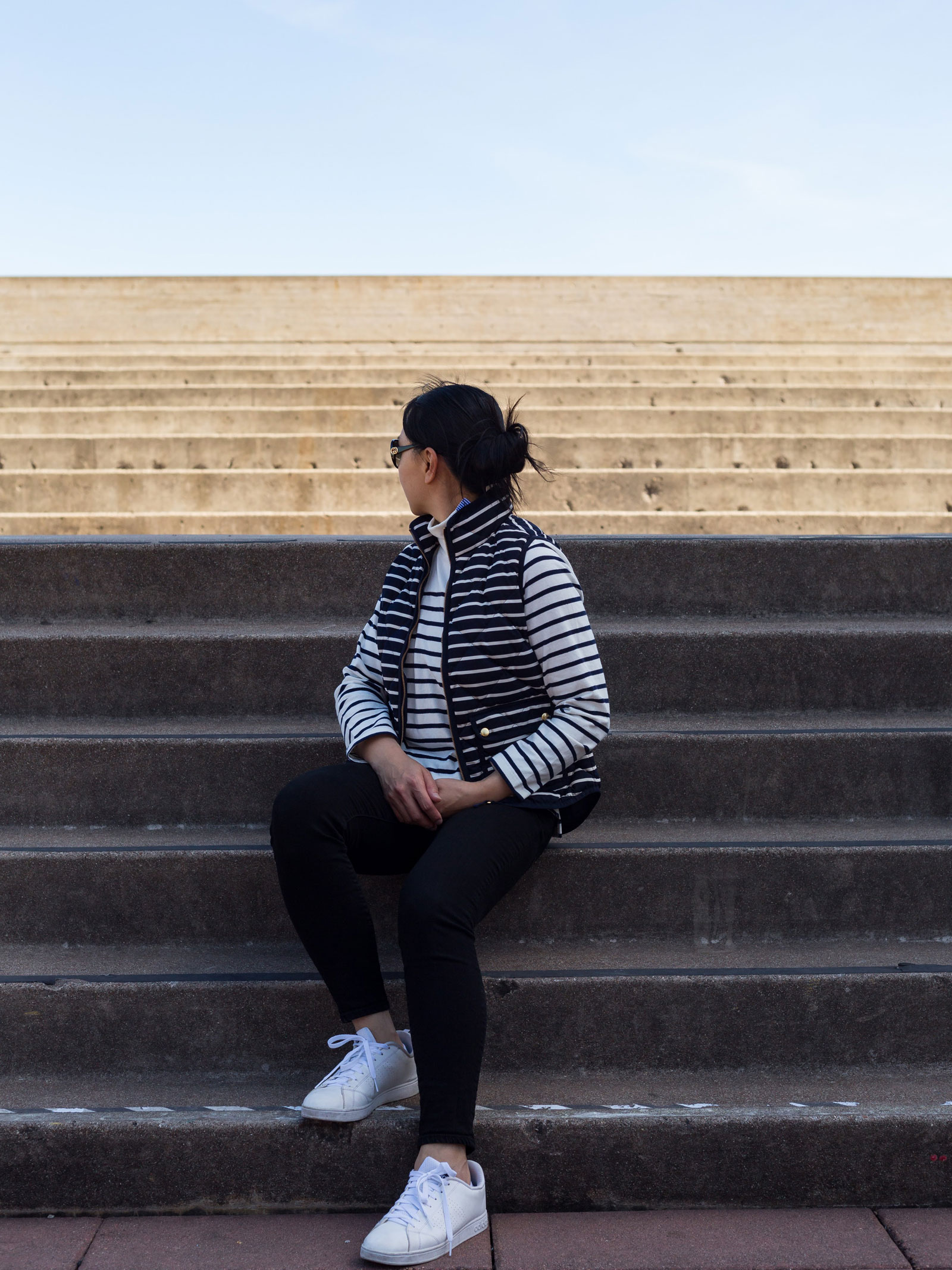Striped mockneck shirt | striped vest | black skinny jeans | white tennis shoes | see the full look at www.shoppingmycloset.com #falloutfit #layering #stripes #stripedvest