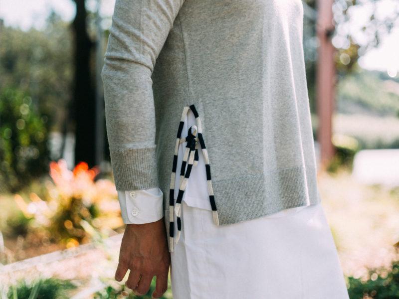 Grey side slit sweater with ties   white silk shirt   white skirt   grey lace heels   www.shoppingmycloset.com