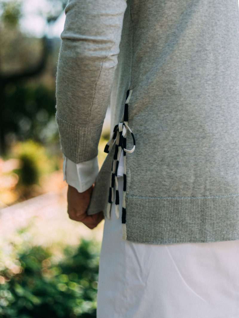 Grey side slit sweater with ties | white silk shirt | white skirt | grey lace heels | www.shoppingmycloset.com